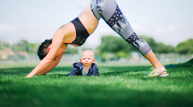new mom practices fitness routine outside