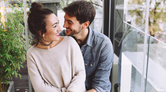 happy couple expressing joy over positive pregnancy test