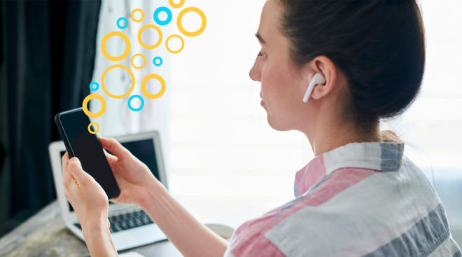 woman with ear buds listening to her podcast