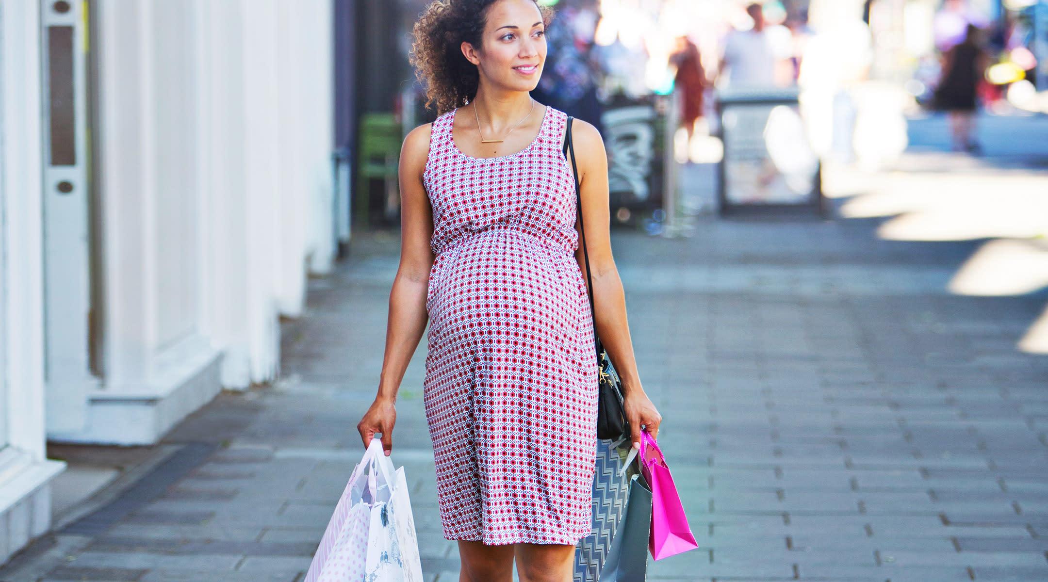 pregnant woman walking shopping maternity fashion