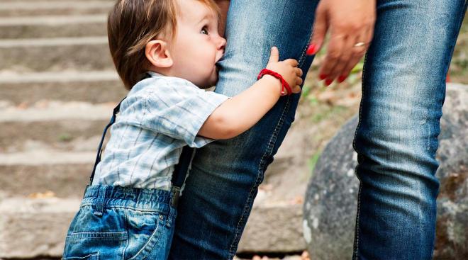 toddler biting woman's leg