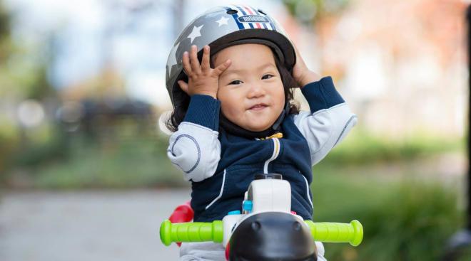toddler riding bike with toddler bike helmet