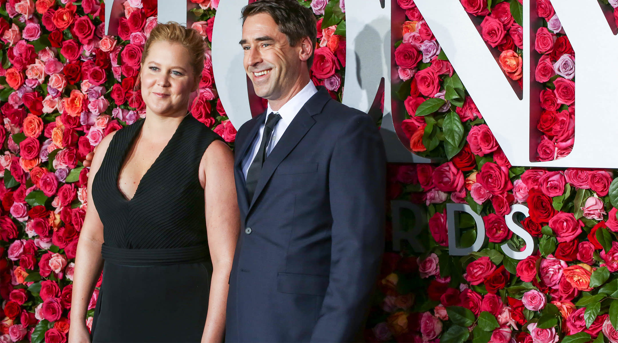 amy schumer announces she's pregnant, pictured with her husband chris fischer