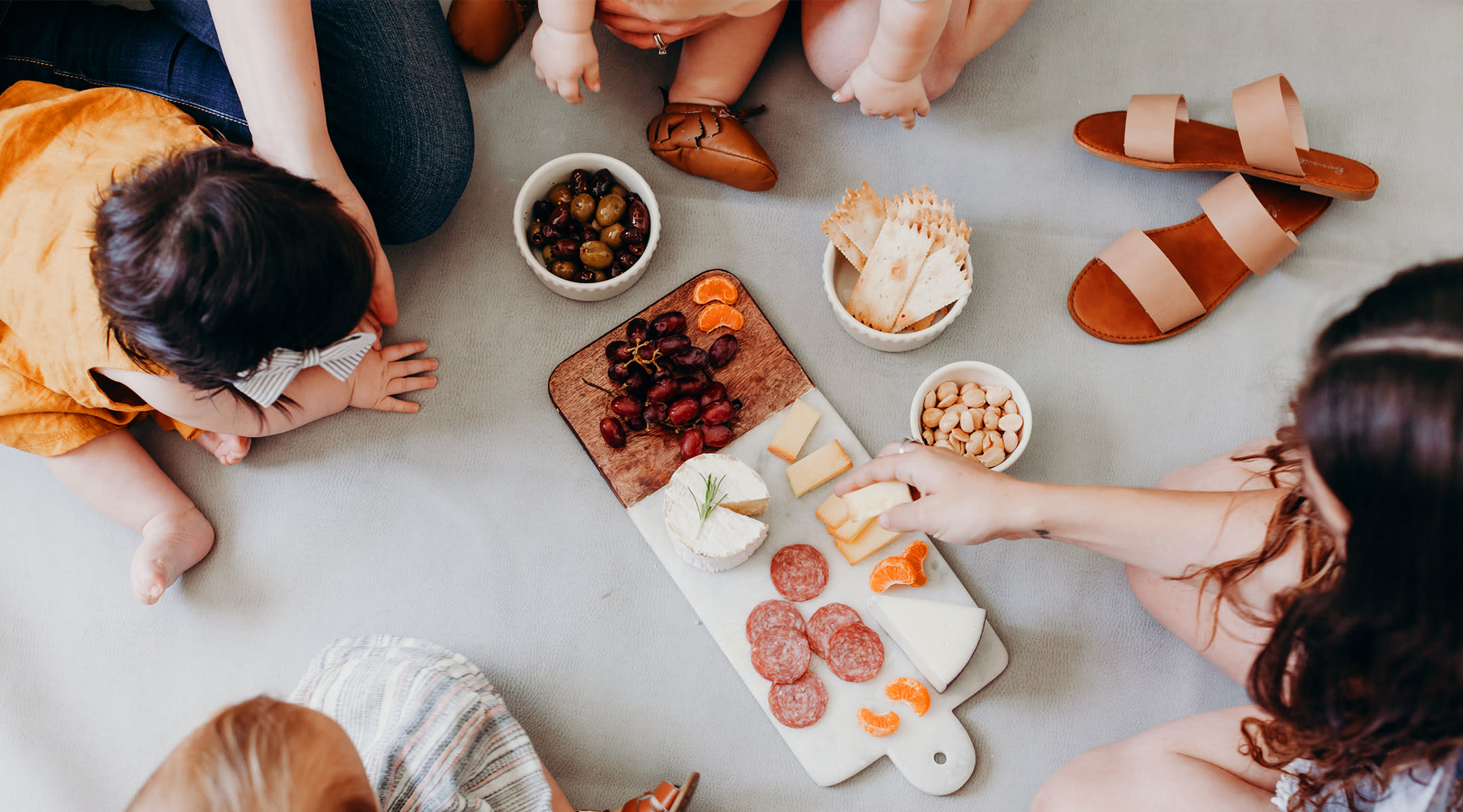 group of moms and babies celebrating small moments with mini picnic