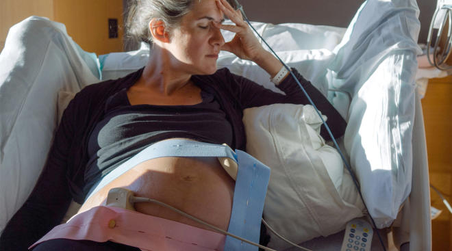 upset woman at hospital in labor