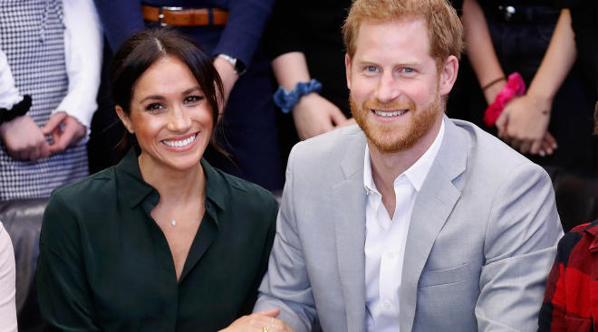 meghan markle announces she's pregnant with next royal baby, pictured with prince harry