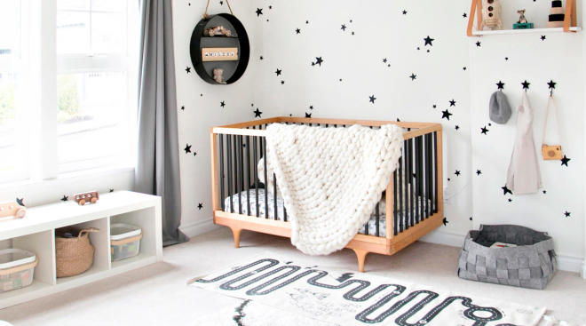 Gender neutral baby nursery black and white theme with stars on the walls