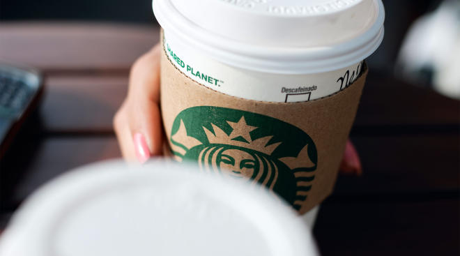 hand holding starbucks coffee cup