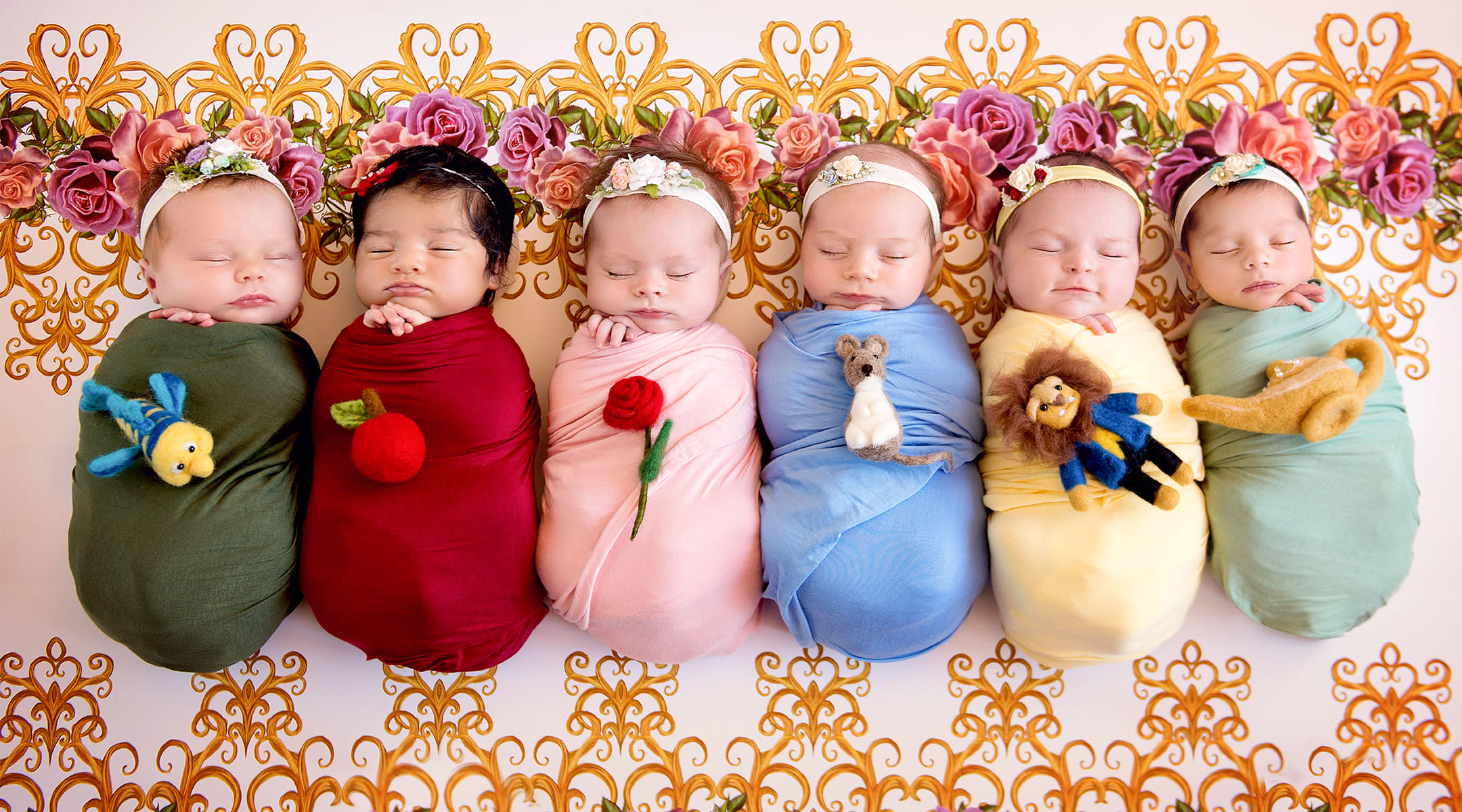 newborn dressed as disney princess