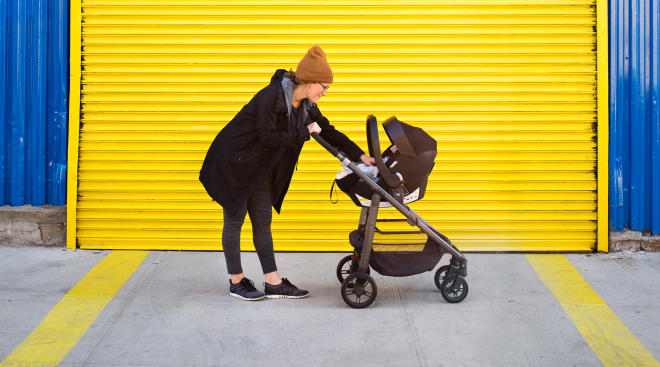 mom using travel system stroller for her newborn baby