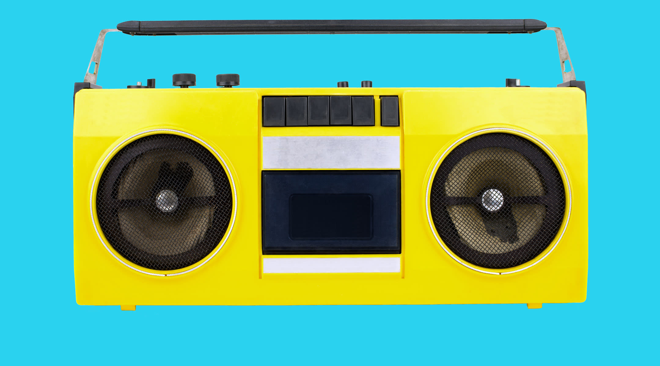 Yellow retro boom box with blue background.