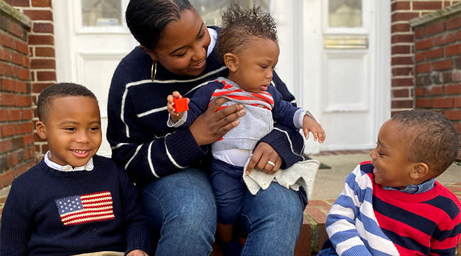 The author Jen Lee pictured with her three black sons on her stoop.