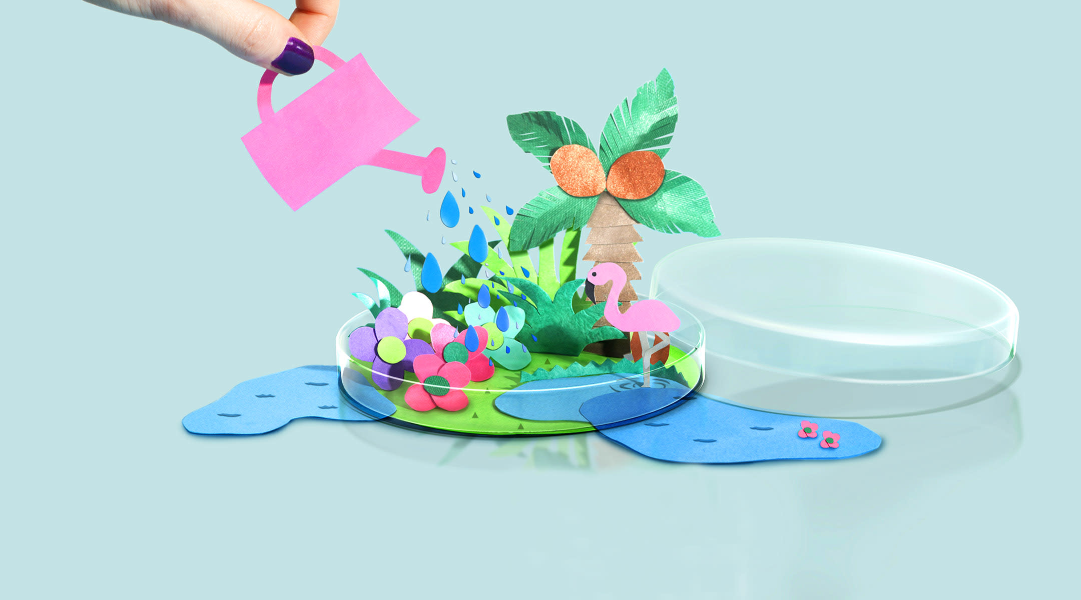 Miniature paper replica of plants and flamingo in petri dish being watered