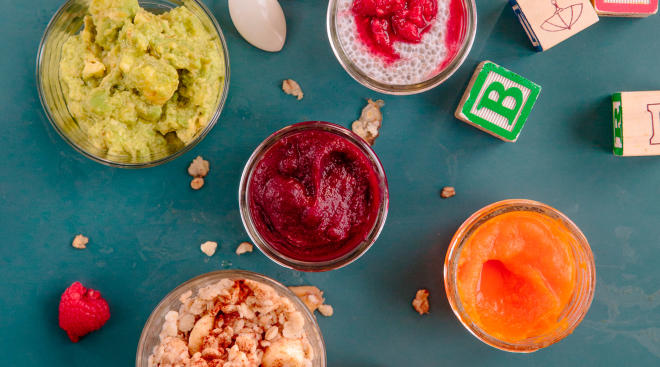 delicious homemade baby food in jars arranged on a surface