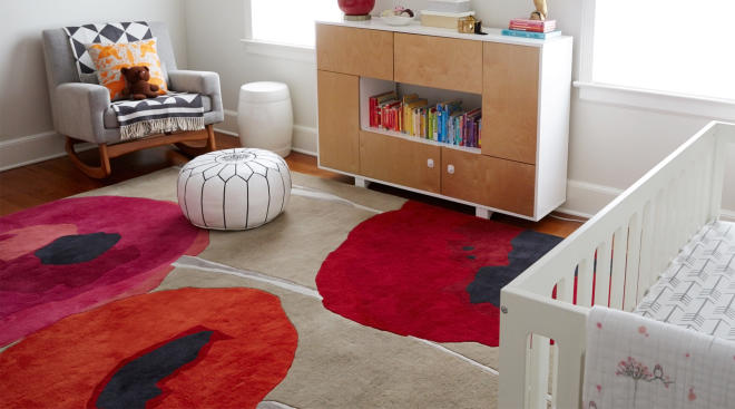 bright and bold floral rug in nursery