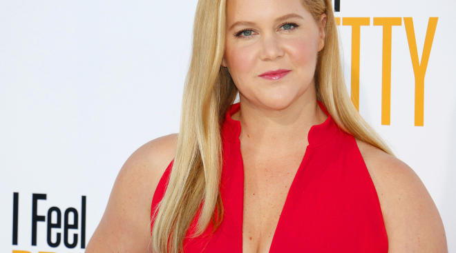 amy schumer wearing a red dress