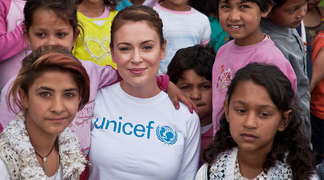 Celebrity Alyssa Milano pictured with children during UNICEF volunteer trip to Kosovo.
