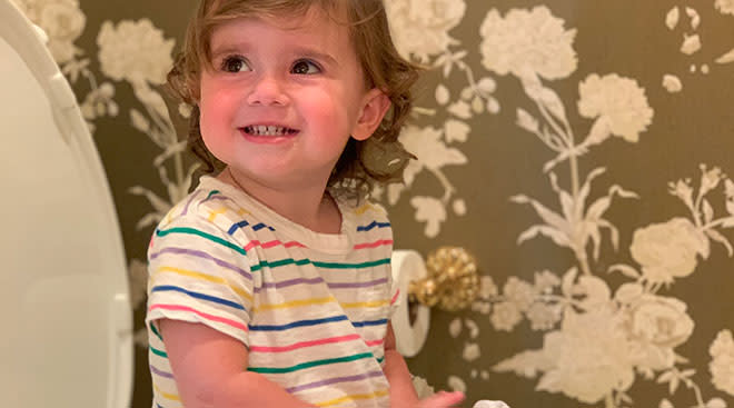 toddler girl learning  during potty training lessons