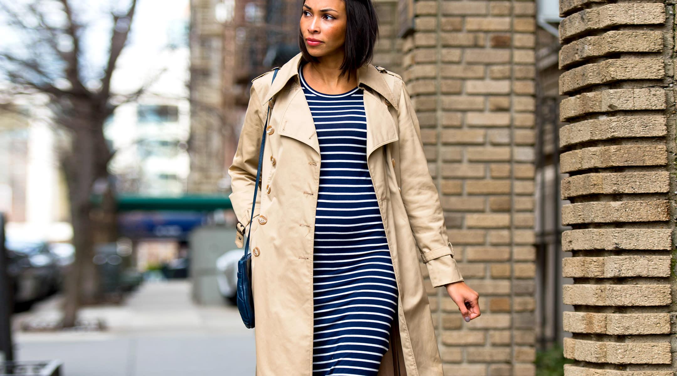 stylish pregnant woman walking outside