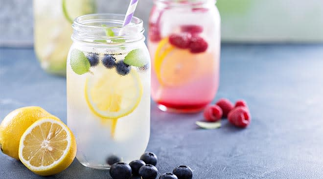 water in mason jars infused with fruit like lemon and raspberries