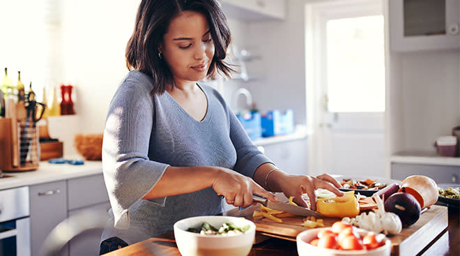 Woman cooking healthy meal in the kitchen.