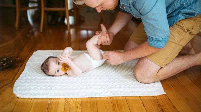 dad checking baby diaper