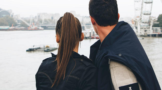 couple looking away over body of water