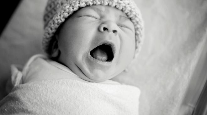 newborn yawning baby