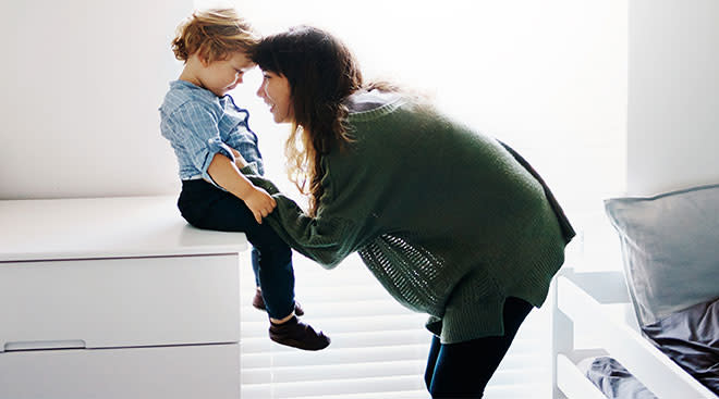 mom having serious conversation with her toddler son