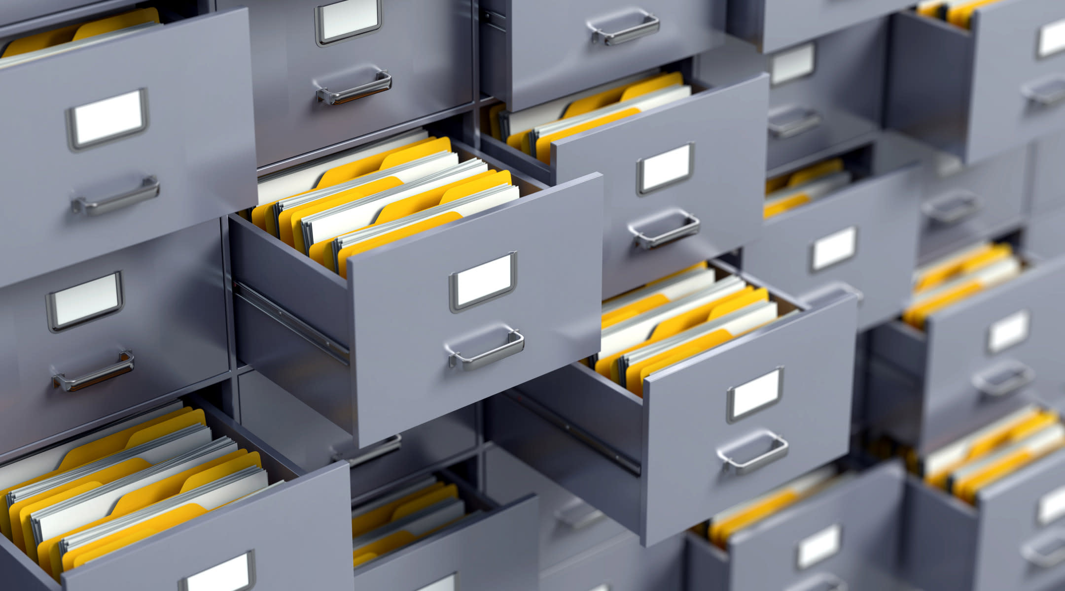 Gray filing cabinets with medical records.
