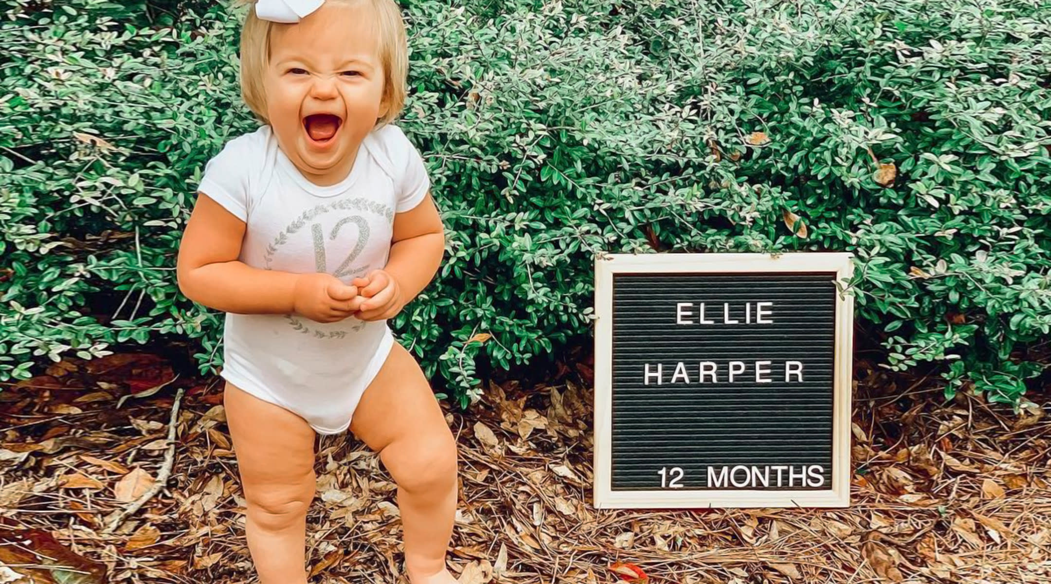 first birthday excited baby pictured with letterboard