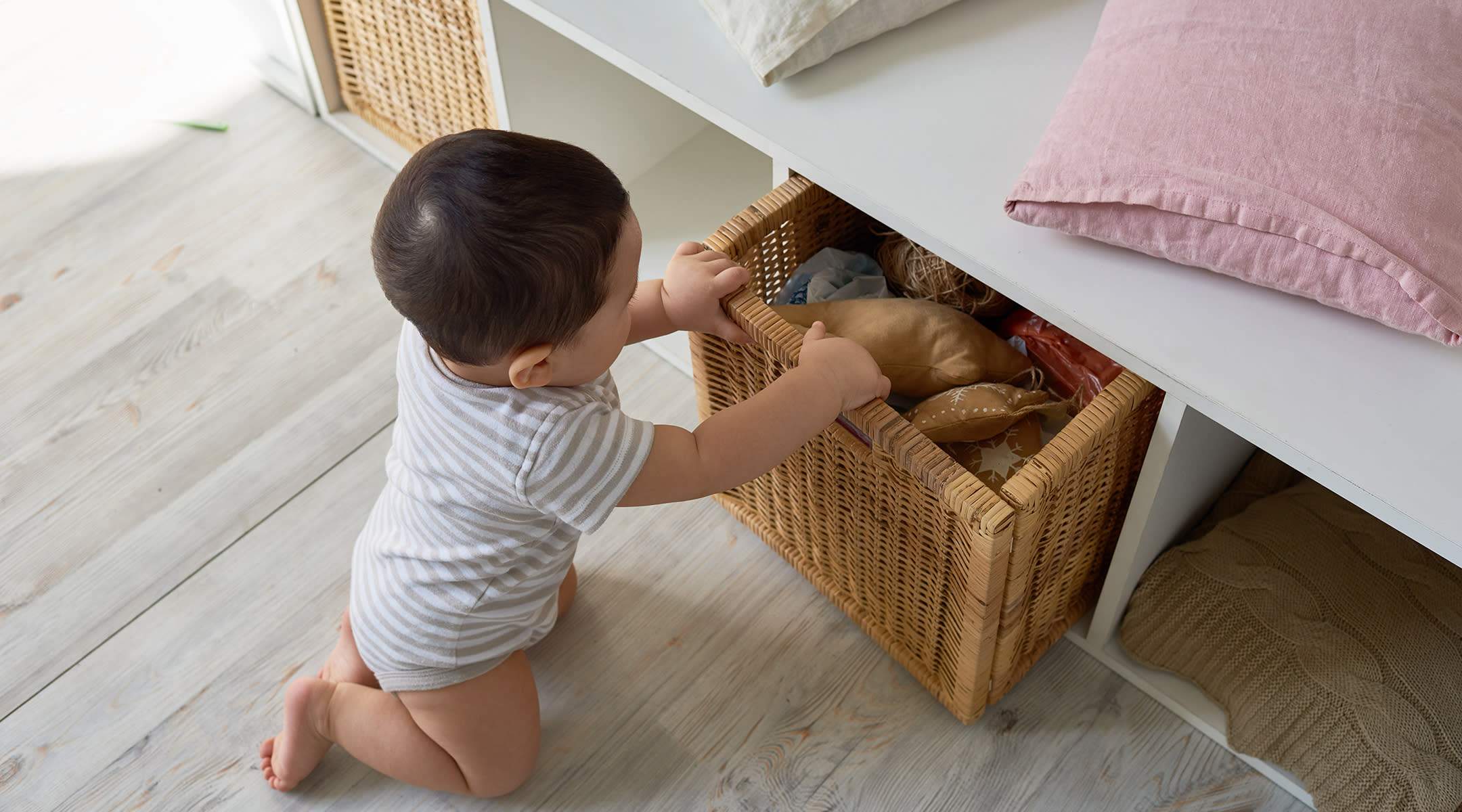 Baby Playing In Drawers