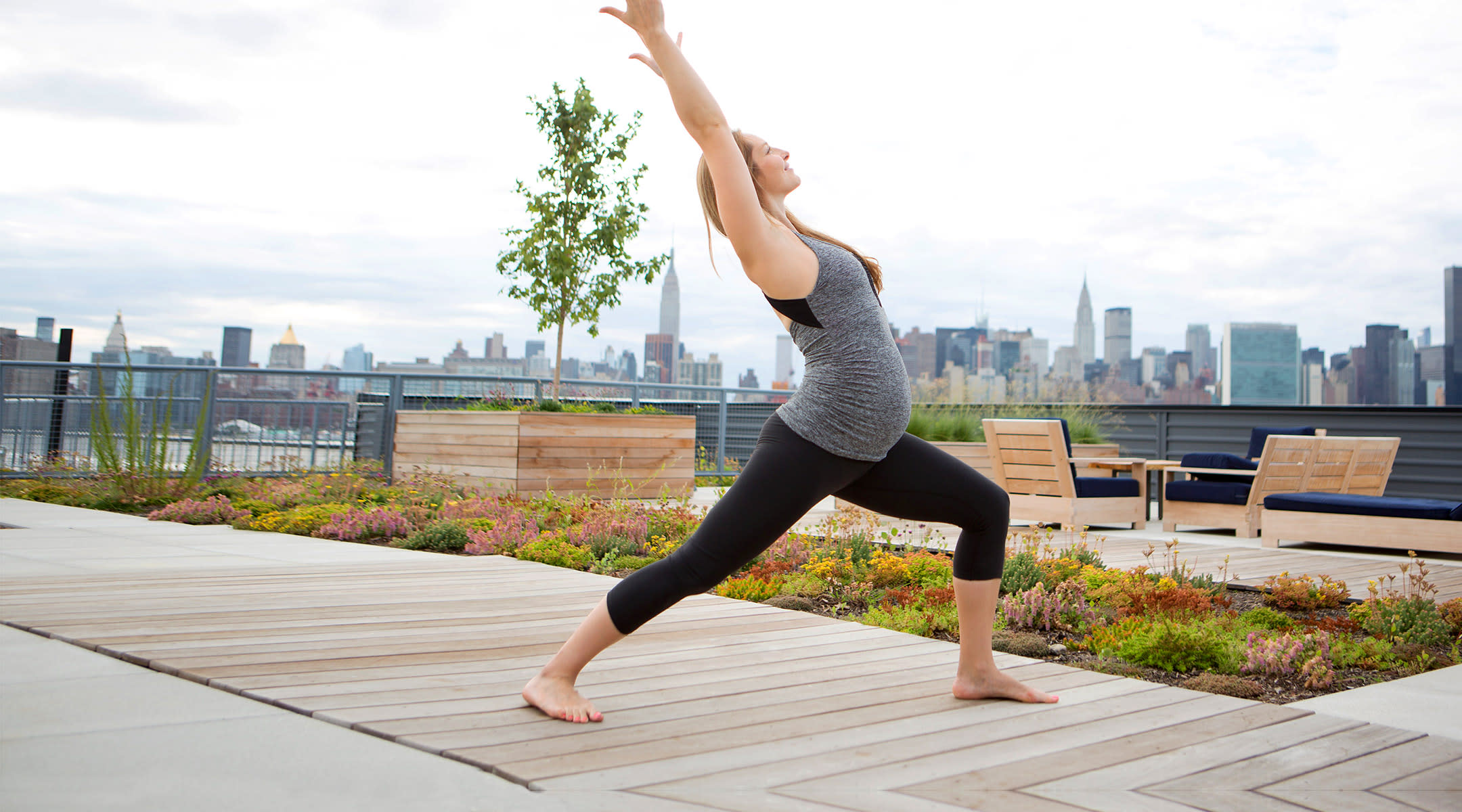 pregnant woman exercise yoga rooftop