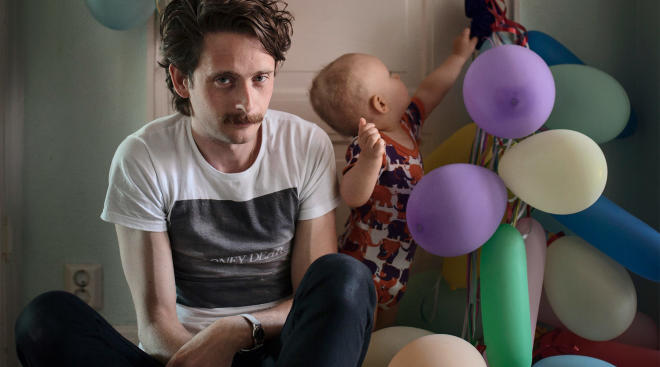 swedish dad on paternity leave, with baby playing with balloons
