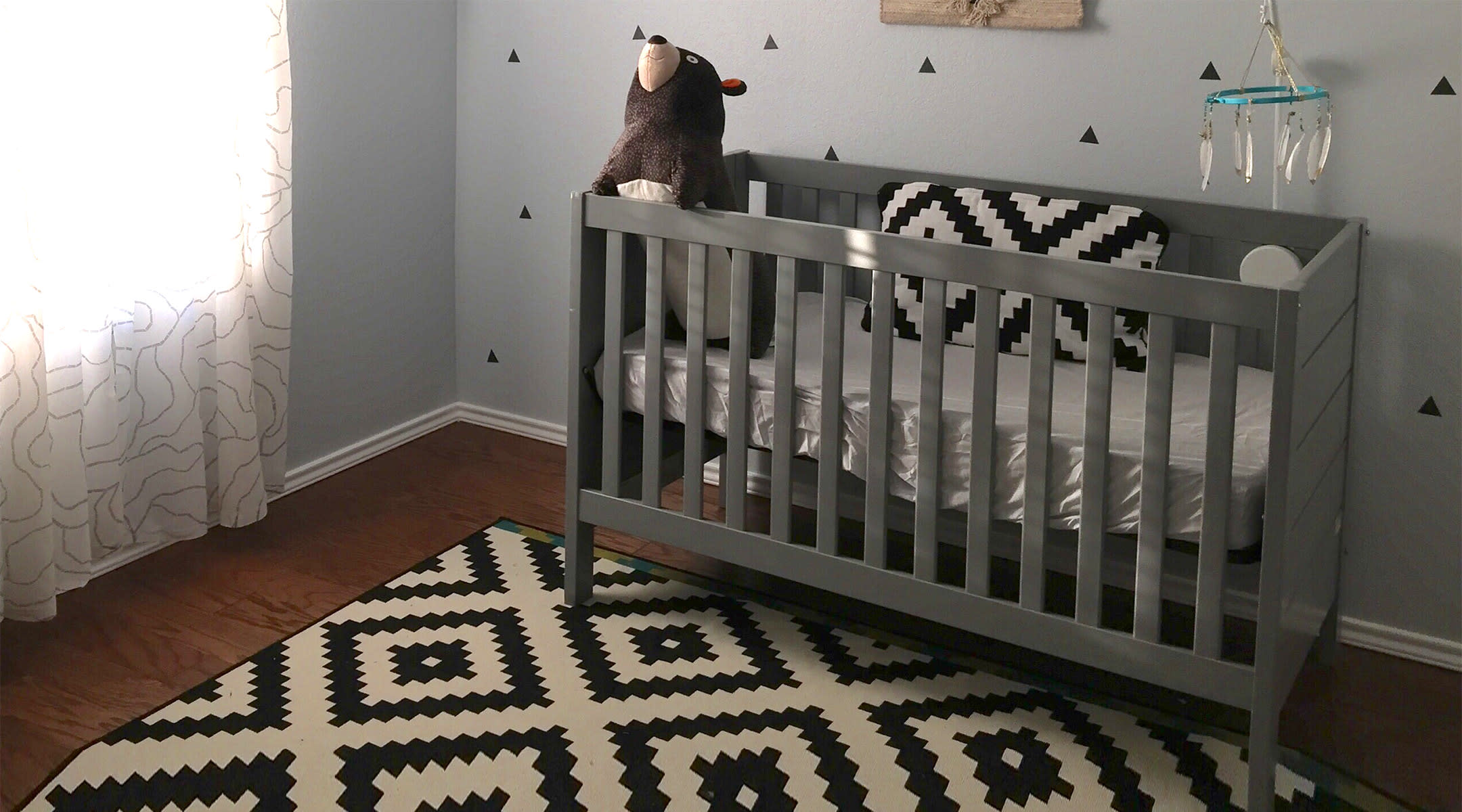 hip nursery gray crib and chevron rug