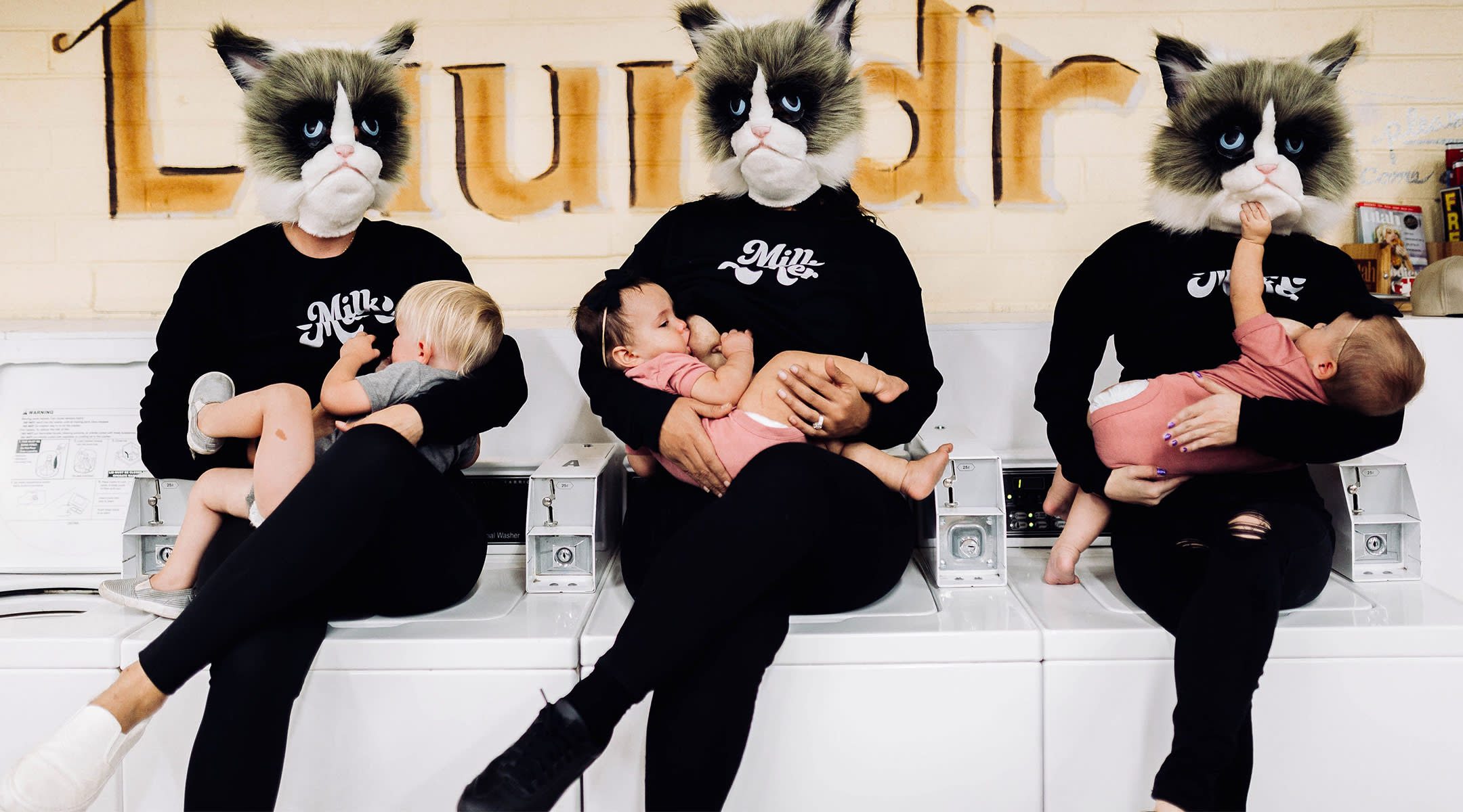cover up breastfeeding stance image, showing women breastfeeding with cat masks