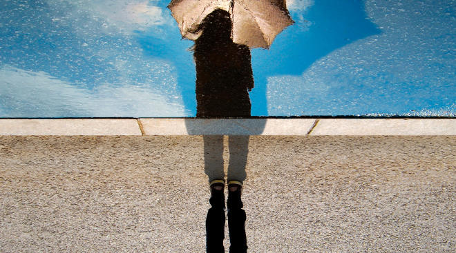 sad woman's reflection in the rain experiencing chemical pregnancy