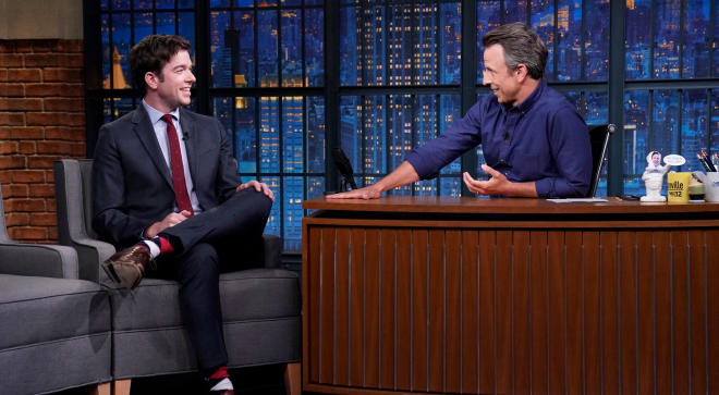 John Mulaney announces pregnancy news during Late Night with Seth Meyers