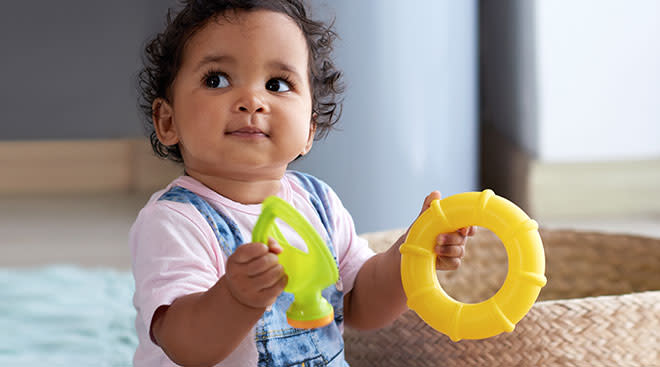 baby playing with ring toy