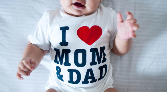 baby wearing i love mom and dad onesie