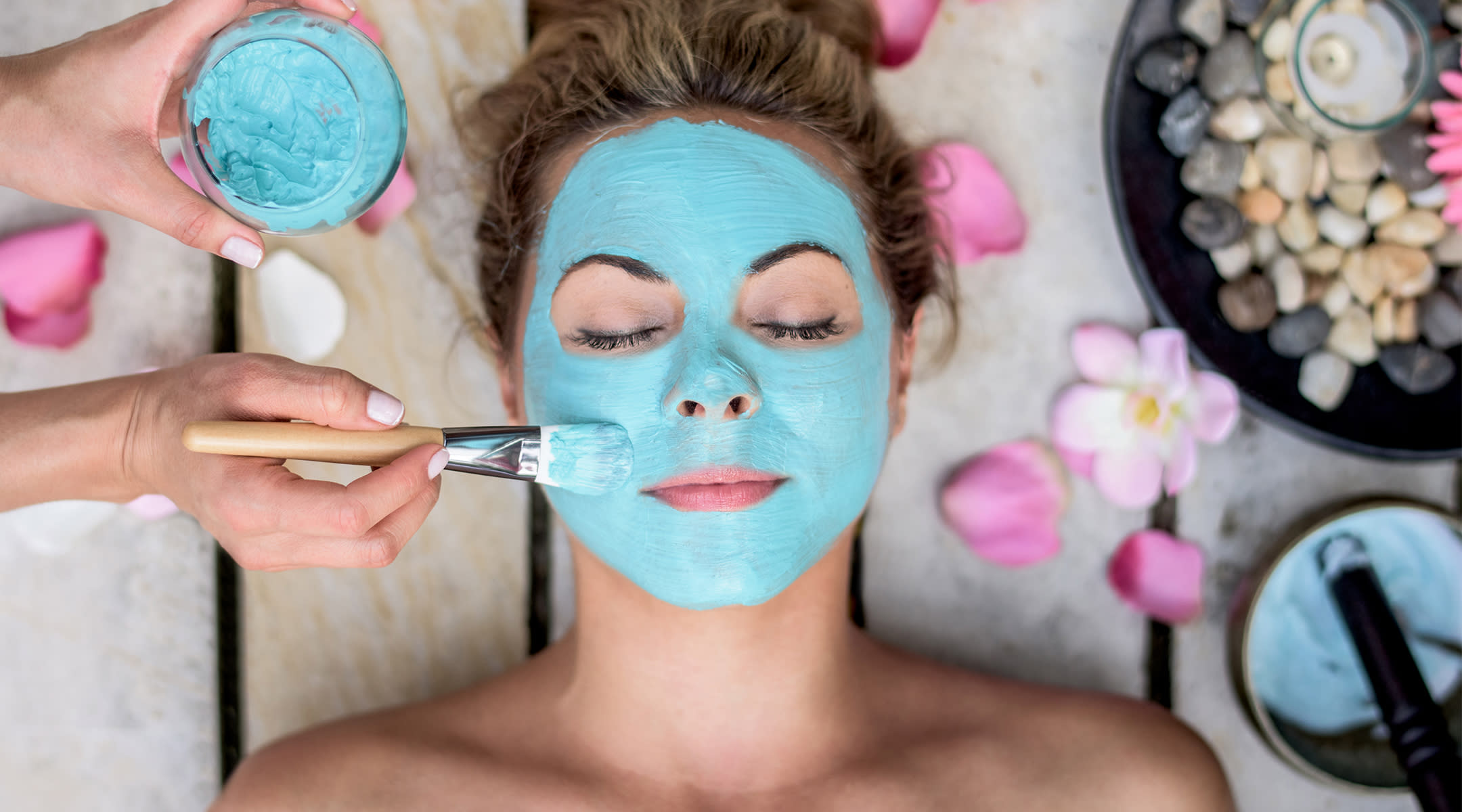 Woman getting a facial with a blue mask