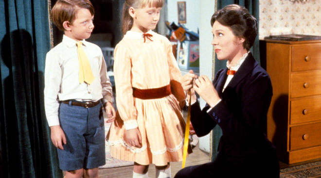 a picture of two children with Mary Poppins from the classic movie