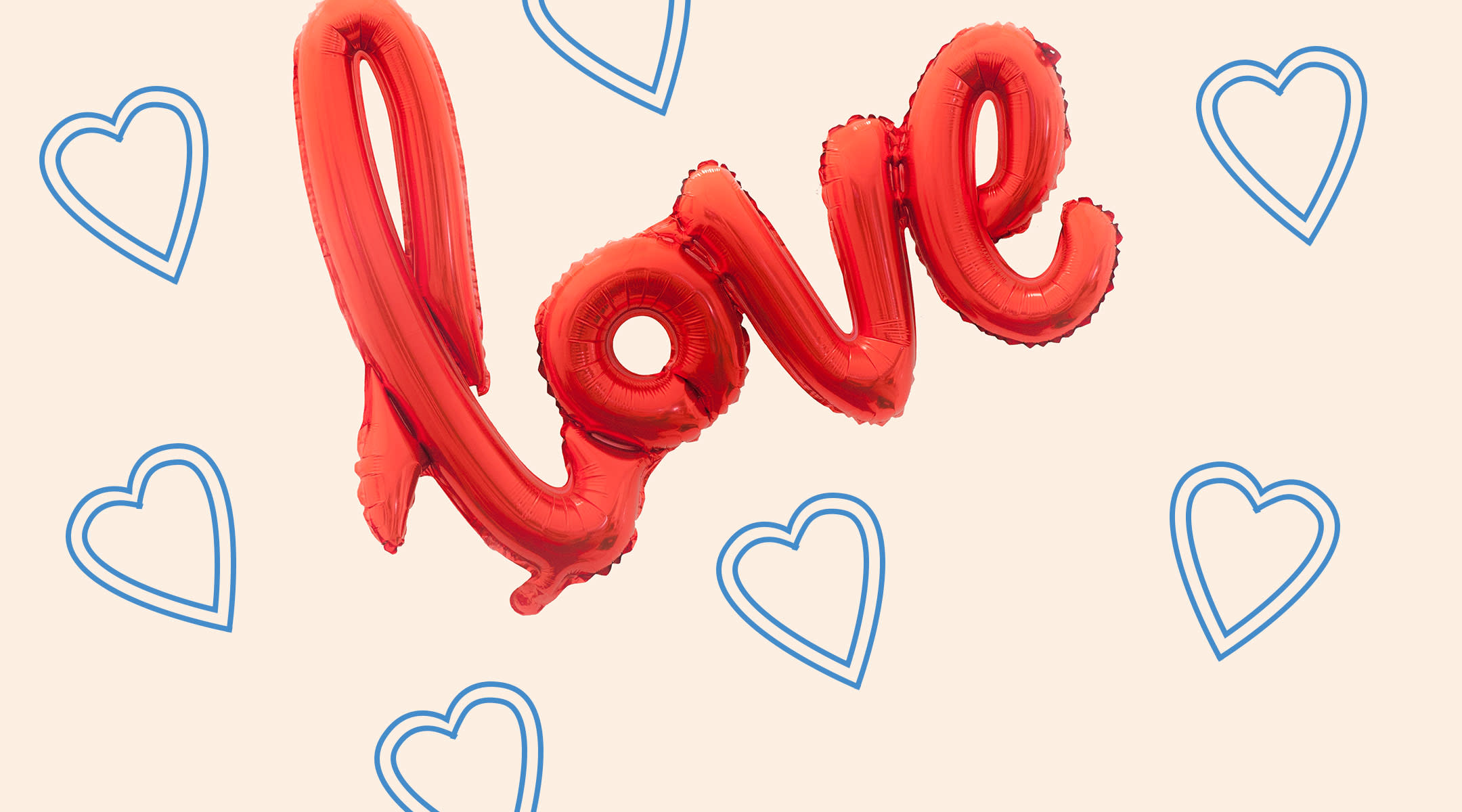 red balloon letters that spell out love with collage of blue hearts