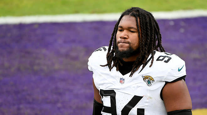 Jacksonville Jaguars NFL player dawuane smoot walks off flield