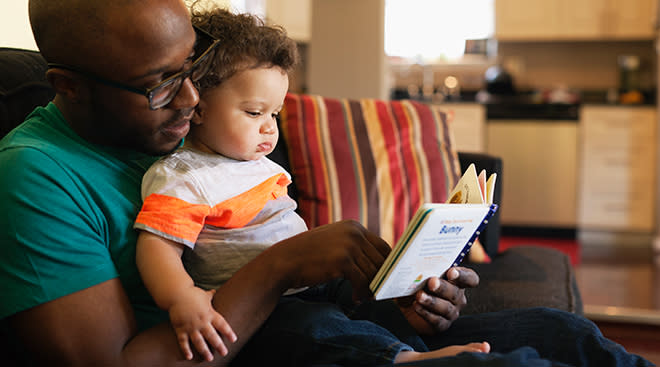 dad reading to toddler