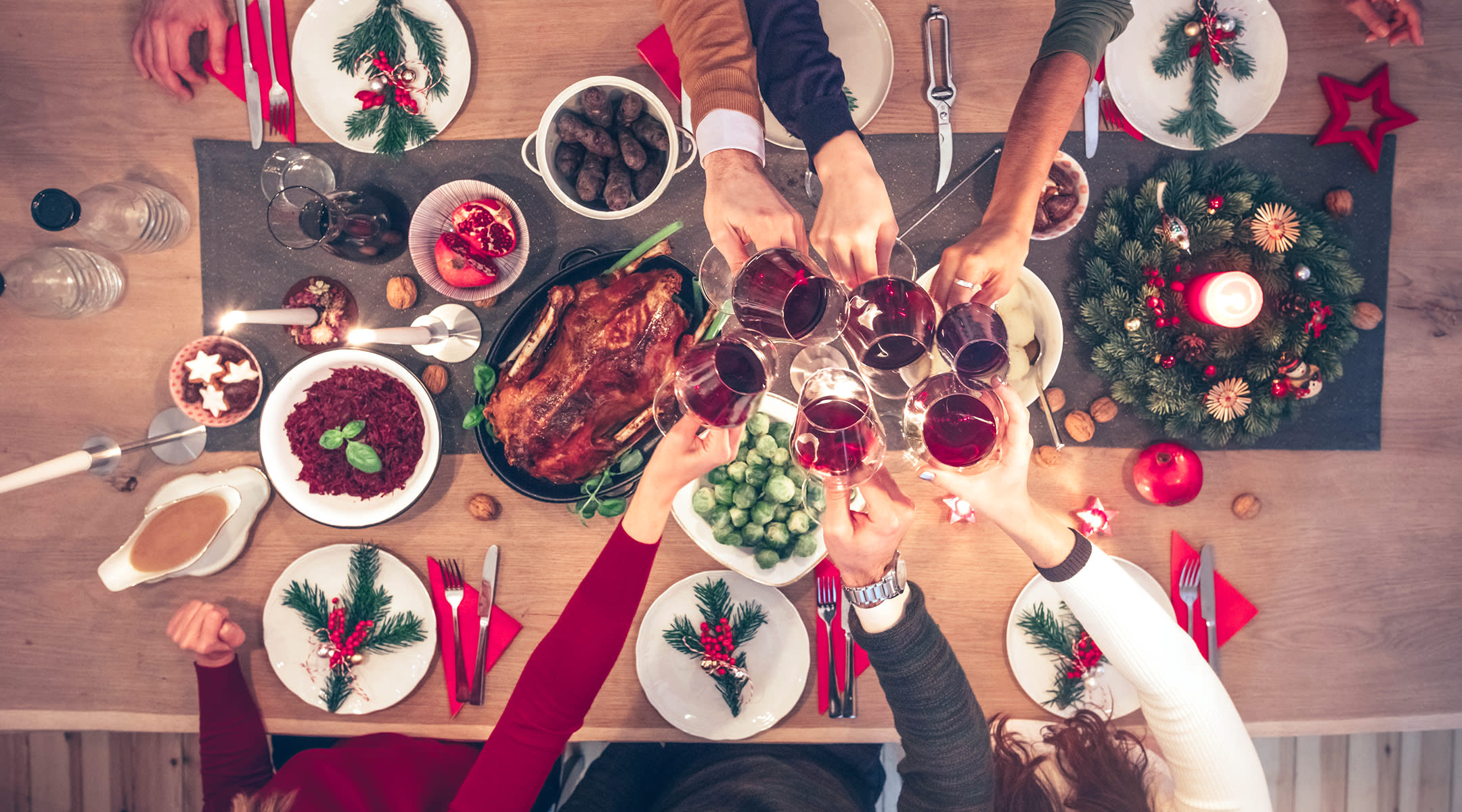 Adults Drinking Wine At Holiday Party