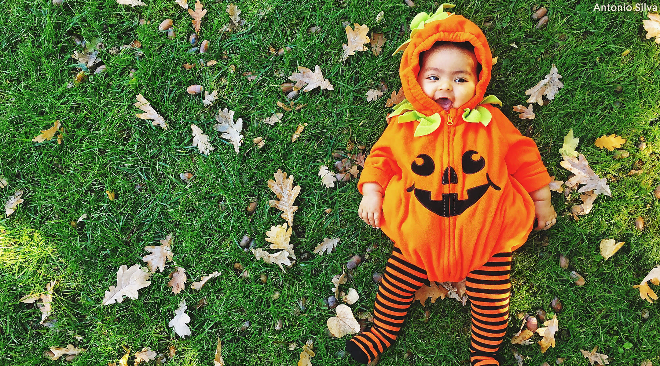 toddler dressed up as pumpkin for halloween