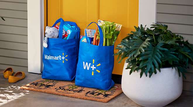 walmart bags in front of door, showing their new membership program