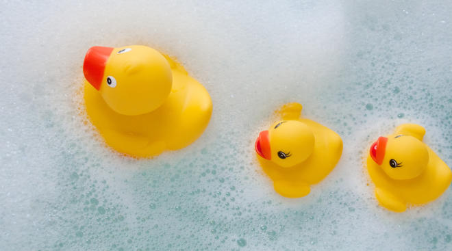 rubber ducks in sudsy bath