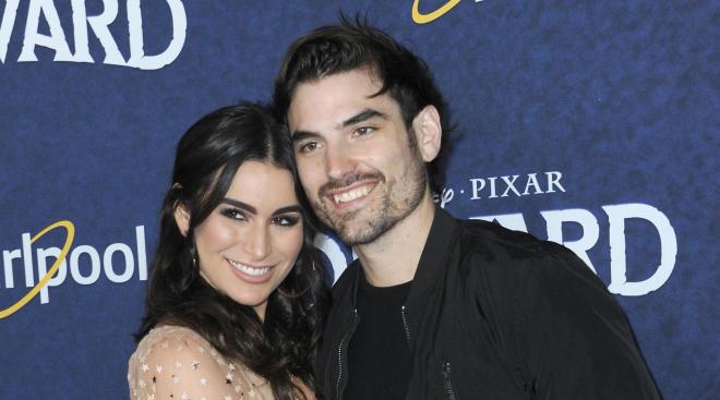 Couple Ashley Iaconetti and Jared Haibon pose on red carpet